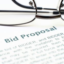 Bid Proposal On Paper With Reading Glasses For BidSource Blog