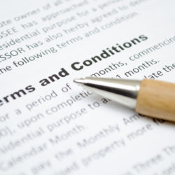 Terms and conditions ona valet trash service contract with a wooden fountain pen