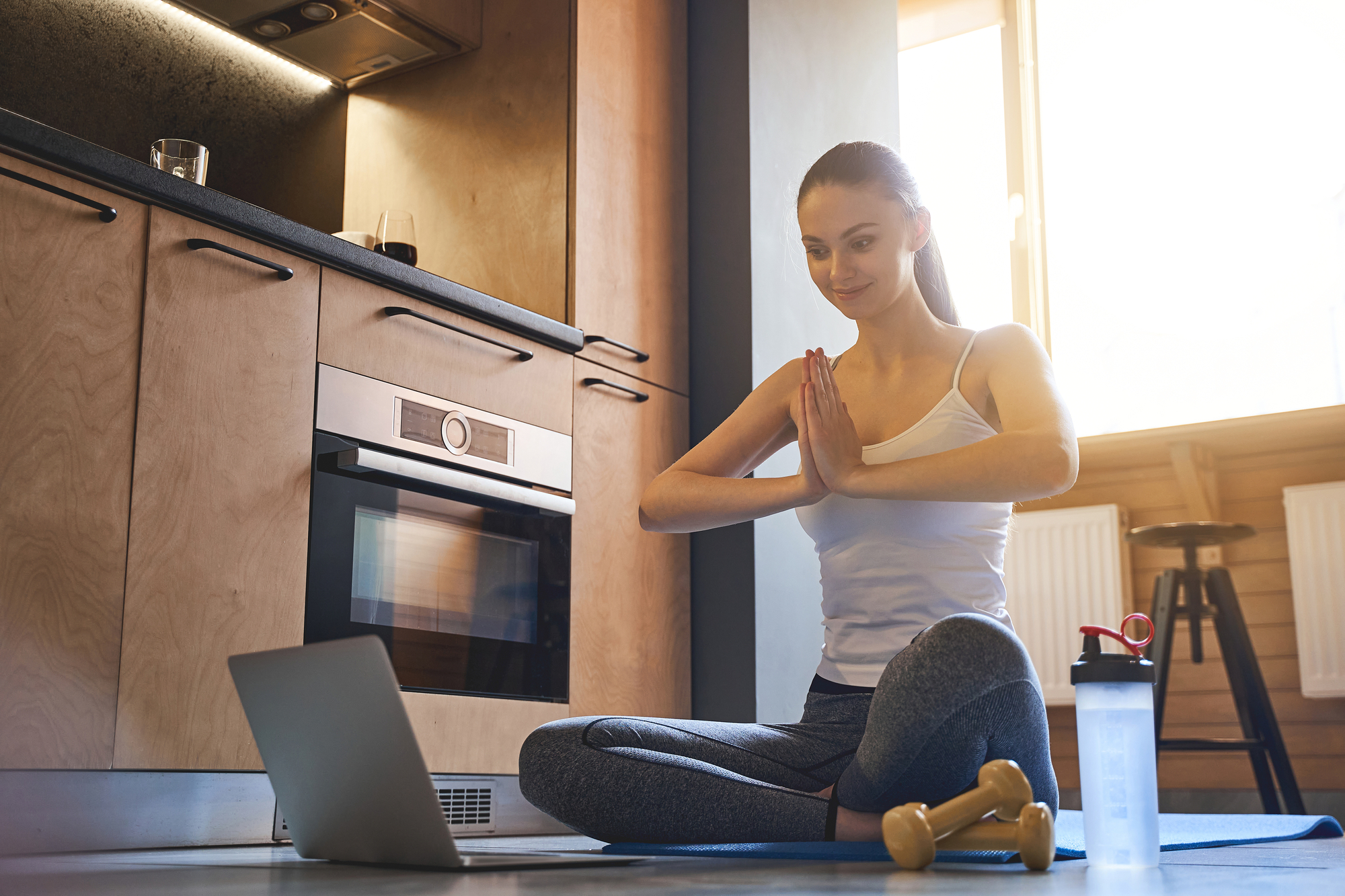 Yoga Instructor Leading Class From An Apartment - Virtual Resident Events For Apartment Managers