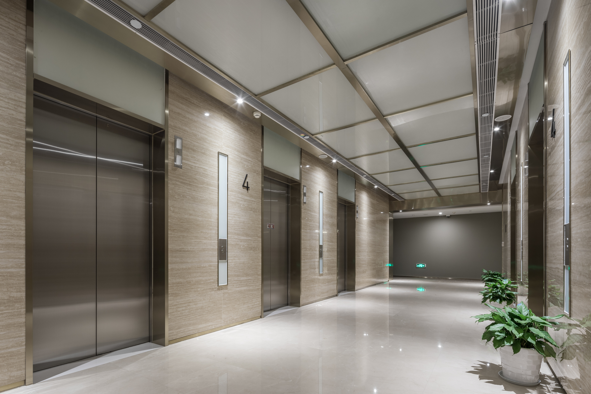 Elevators In Modern Office Lobby Serviced By Independent Elevator Companies