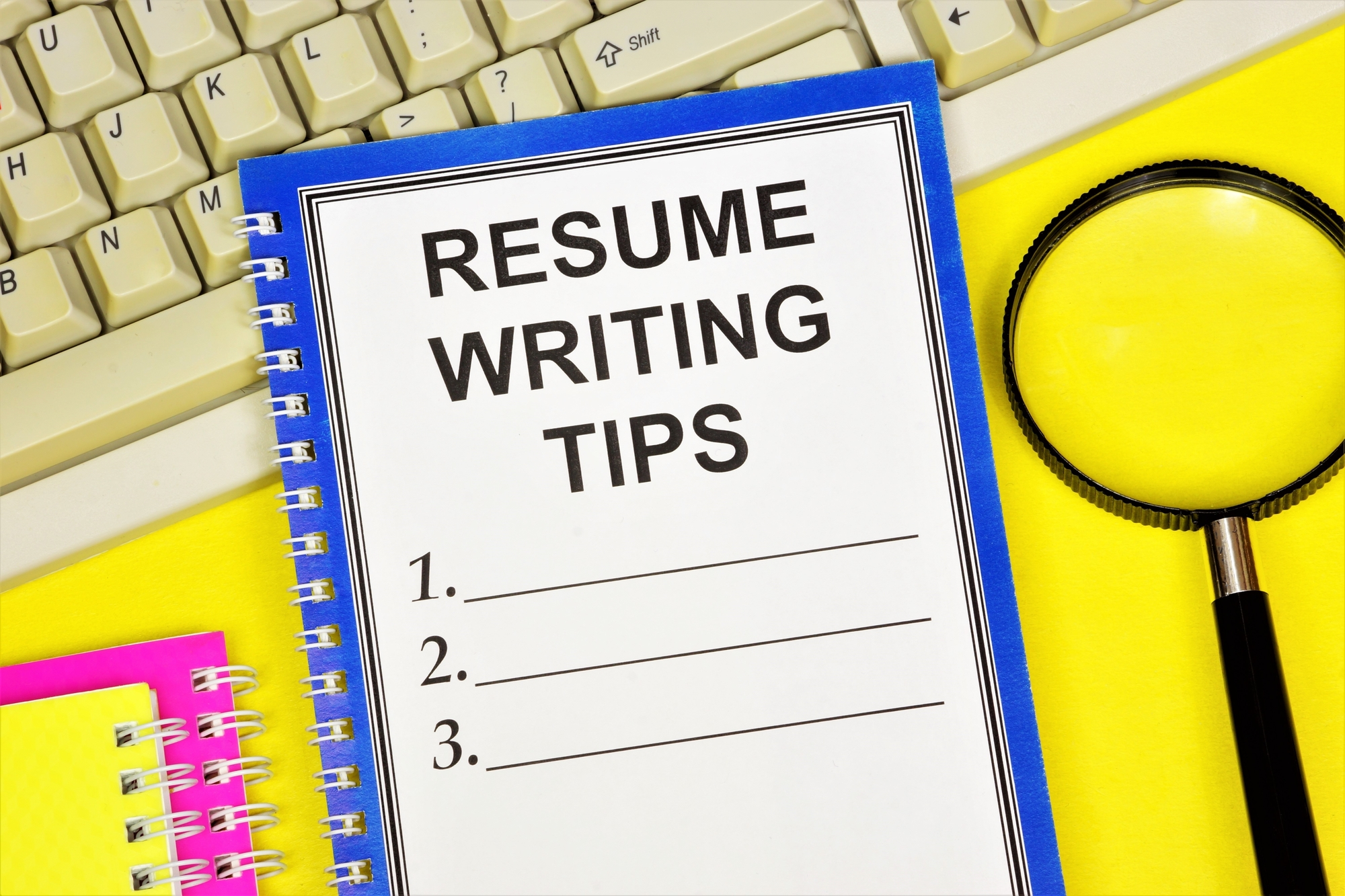 Note Pad Over Computer Keypad With Pen For Writing Down Property Management Resume Tips