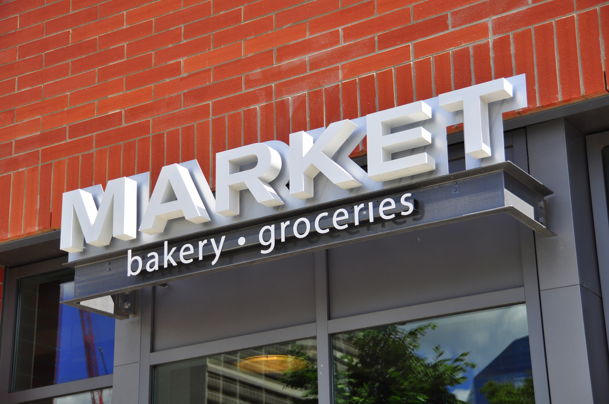 Market Bakery and Groceries in Metal Channel Letters Attached To Brick Building