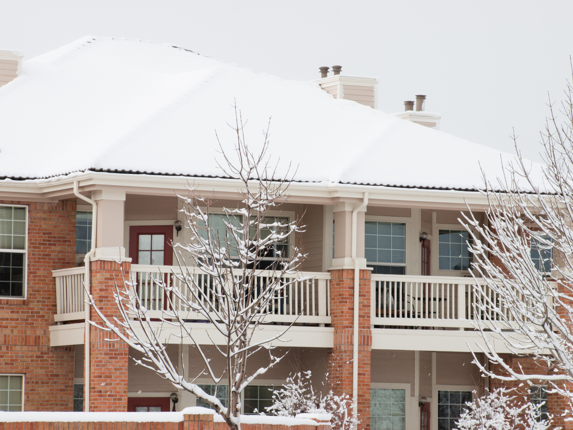 Snow Covered Apartment Building Seeking Rental Property Tenants In Winter