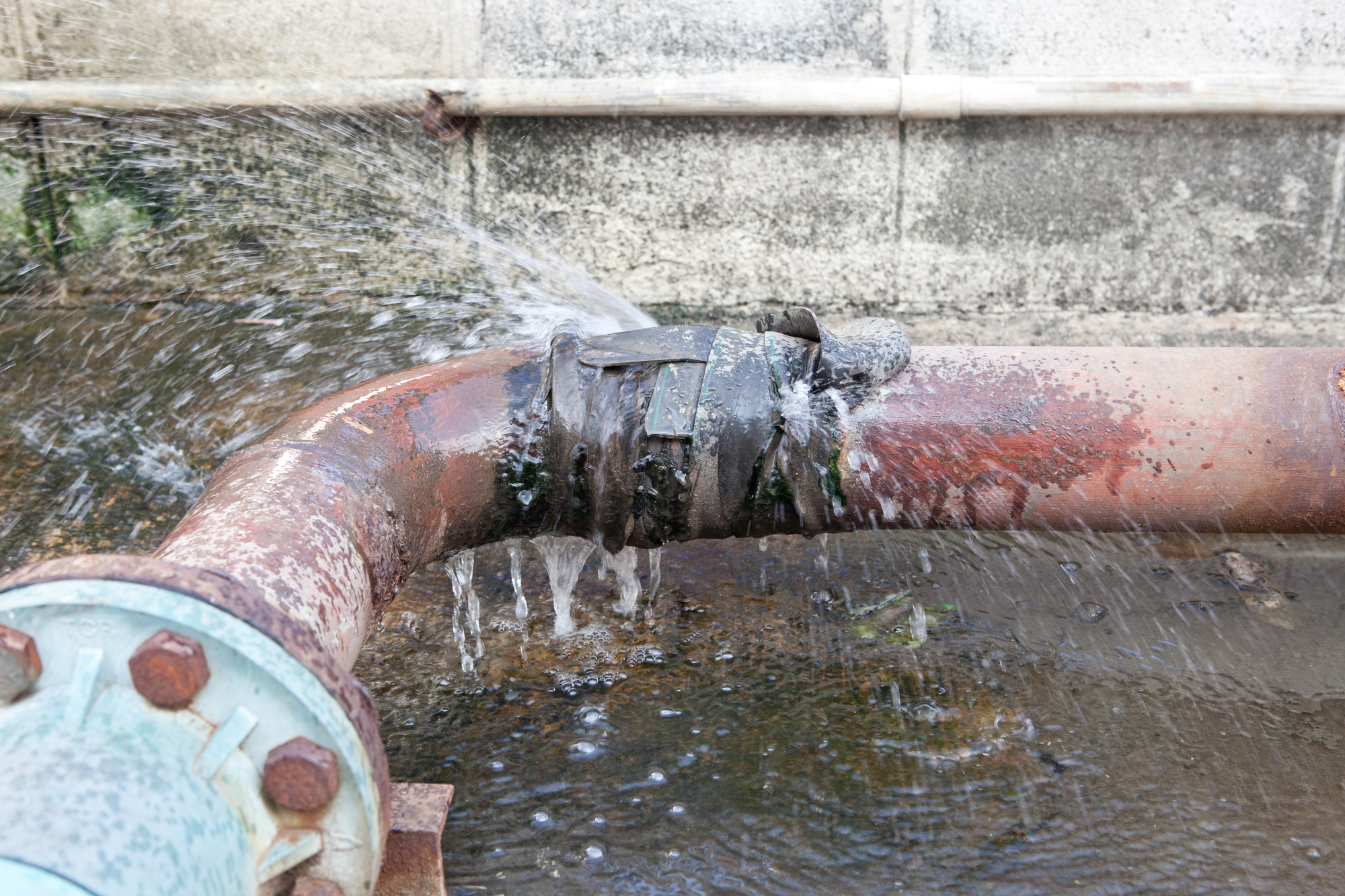 Old Leaking Pipe Behind Concrete Wall Eligible For Commercial CIPP Lining Restoration